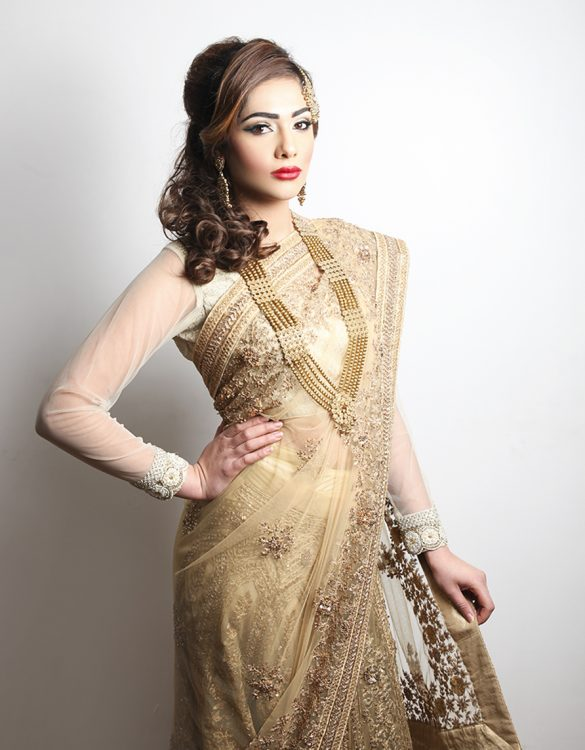 Lengha Saree- Gold complete with fine hand embroidered, pleats and paloo. In gold net. This is perfect for any occasion and offers comfort and style.Take a moment to browse our online collection, many outfits are available through the website alongside a simple, easy to tailor service with our master tailor. Alternatively if you'd prefer to call or discuss any sizing queries, fabrics and delivery options then why not contact us today on: 0121 523 9000 *For more information on our collection, fabric choices and colour options; please send us a quick message to the Payals Bridal department at info@payals.co.uk